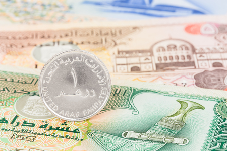 arabic currency: United Arub Emirates dirham coin stand on banknote money Stock Photo