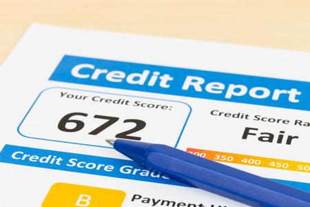 Fair credit score report with pen