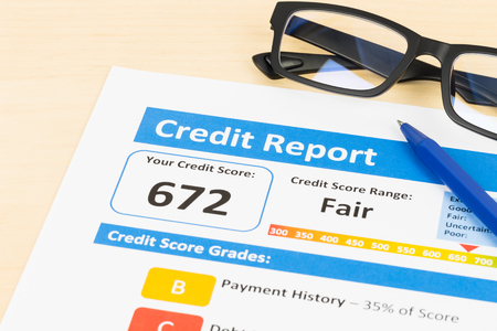 credit report: Fair credit score report with pen