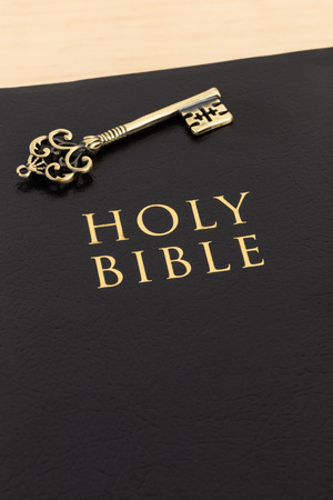 theology: Holy bible and vintage key on cover concept theology study