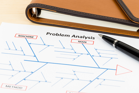 Problem solving using cause and effect or fishbone diagram with pen and organizer Stock Photo