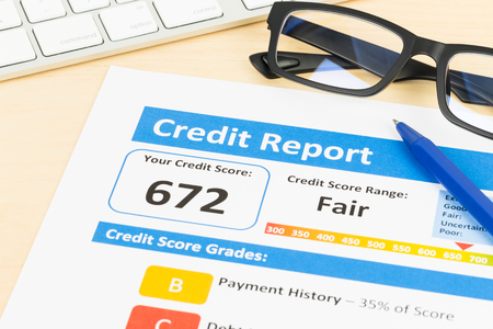 credit report: Fair credit score report with pen and keyboard; document is mock-up