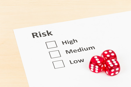 Risk assessment check box and dice Stock Photo