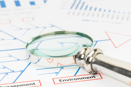 fishbone: Problem solving using cause and effect or fishbone diagram with magnifier Stock Photo