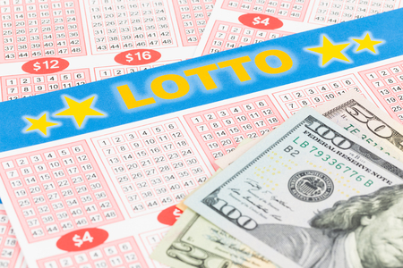 lottery win: Lotto ticket gambling with dollar banknote, ticket is mock-up