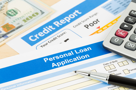 Personal loan application form poor credit score with calculator, dollar money, and pen