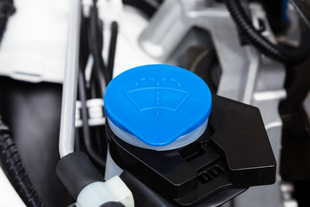 Car engine windshield washer fluid reservoir cap close-up