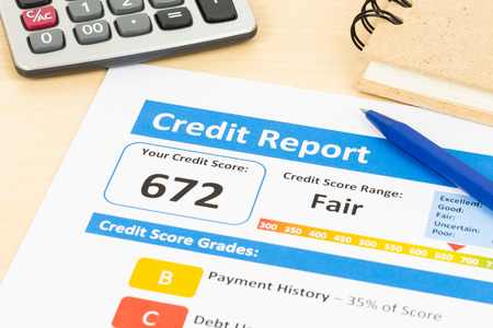 creditworthiness: Fair credit score report with pen and calculator; document and the report are mocked-up
