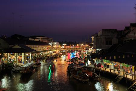 AMPHAWA, THAILAND - Dec 12, 2014: Amphawa market at twilight, famous floating market and tourist destination in Samut Songkhram province