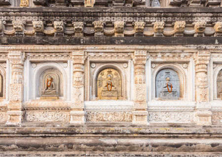 gaya: Decorated panel around pagoda at Mahabodhi Temple, Gaya, India Stock Photo