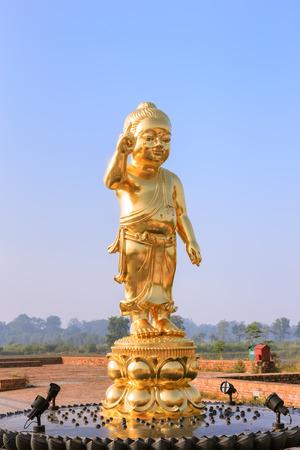 gaya: Lumbini, Nepal - October 23, 2015: Baby Buddha statue at birthplace of Buddha Siddhartha Gautama