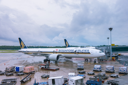 Changi Airport, Singapore - December 1, 2016: Singapore Airlines plane prepare for departure at gate. Editorial