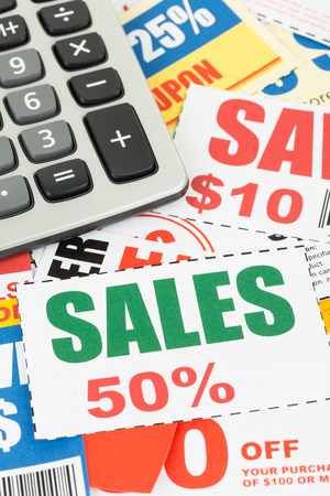 thrifty: Saving discount coupon voucher with calculator, coupons are mock-up Stock Photo