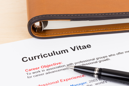 Curriculum vitae and organizer notebook with pen