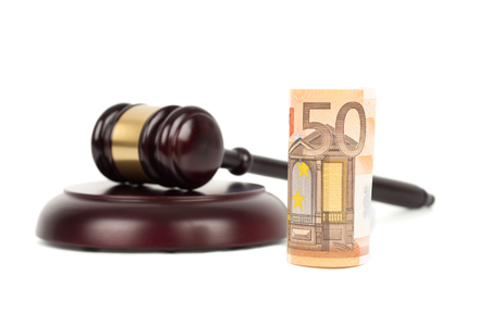 Wooden judge gavel and euro money banknote on white background