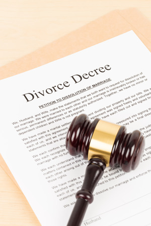 Wooden judge gavel and divorce decree; document is mock-up Stock Photo