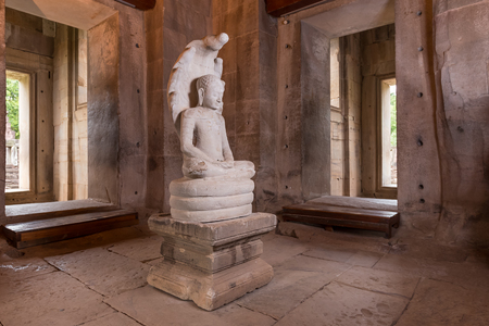 August 9, 2014: White stone carving buddha with naga in Pimai castle