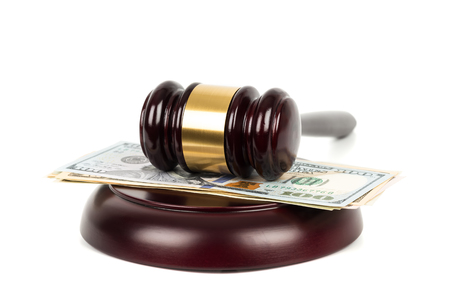 Wooden judge gavel and dollar money banknote on white background