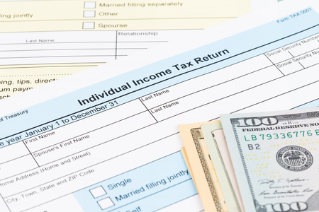 Tax form with dollar banknote; document are mock-up Stock Photo
