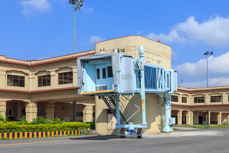 Bodhgaya, Bihar, India - October 16, 2014: Jet bridge ready for docking with passenger plane at Gaya International Airport