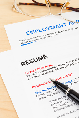 Resume and employment application form with glasses