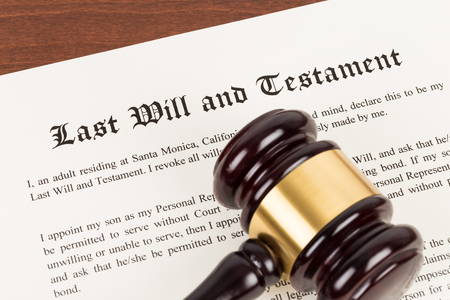 Last will and testament on yellowish paper with wooden judge gavel; document is mock-up Stok Fotoğraf