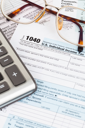 Tax form with glasses, and calculator Stock Photo