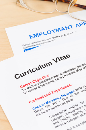 Curriculum vitae and employment application form with glasses Stock Photo