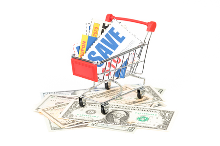 Saving discount coupon voucher in shopping cart on Dollar money banknote, coupons are mock-up