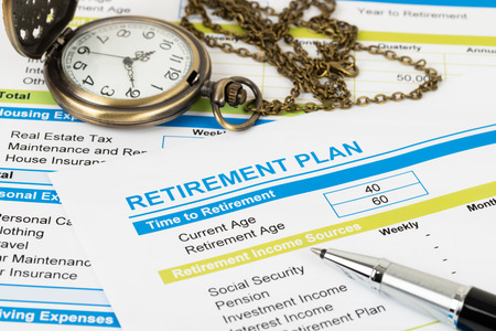 Retirement plan with pocket watch; document is mock-up Stock Photo