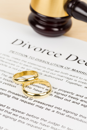 Wooden judge gavel, golden rings, and divorce decree; document is mock-up Reklamní fotografie