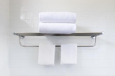 White towel on hanger rack in bathroom 写真素材