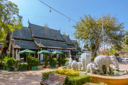 Chiangmai, Thailand - January 09, 2018: Starbucks Coffee at Kad Farang Village. Designed in traditional Lanna temple style.