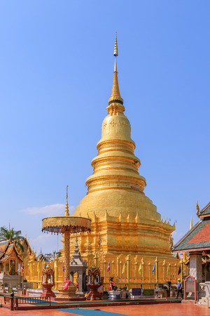 Golden pagoda at Wat Phra That Haripunchai Woramahawihan in Lamphun, north of Thailand Editorial