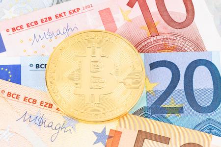 Bitcoin token on euro banknote money