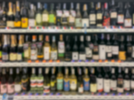 Abstract blurred modern retail supermarket aisle shelves with dark color theme