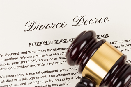 Wooden judge gavel and divorce decree; document is mock-up Фото со стока