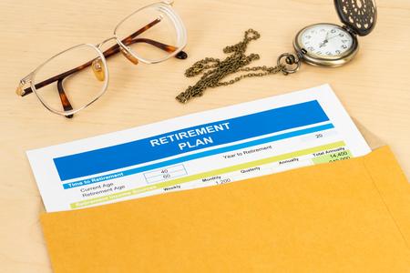 Retirement plan in envelope,  document is mock-up