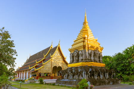 Chapel and golden pagoda at Wat Chiang Man Temple in Chiang Mai, North of Thailand