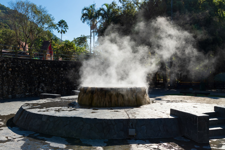 Famous hot spring well in Raksa Warin public park, Ranong, Thailand.