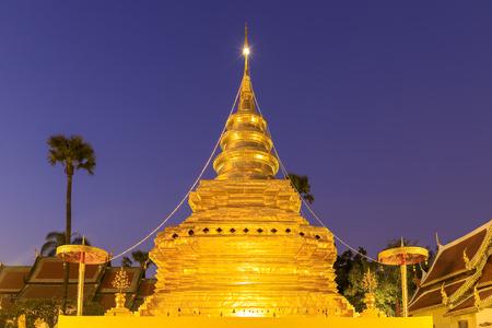 Golden buddha relic pagoda at Wat Phra That Si Chom Thong Worawihan at twilight, Chiang Mai, Thailand.
