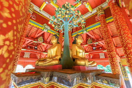 Four Buddha sculpures in pavilion at Wat Pong Sanuk temple and museum in Lampang, North of Thailand