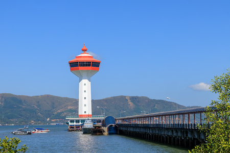 Lighthouse on Andaman sea, custom and immigration office at border to Myanmar, Ranong, Thailand.