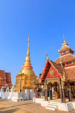 Golden pagoda and Buddha pavilion at Wat Pong Sanuk temple and museum in Lampang, North of Thailand