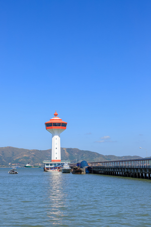 Ranong, Thailand - February 19, 2019: Lighthouse on Andaman sea, custom and immigration office at border to Myanmar.