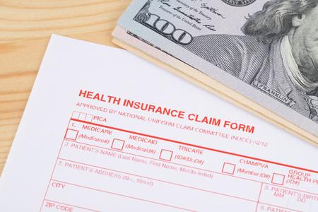 Health insurance claim form on wooden desk Imagens
