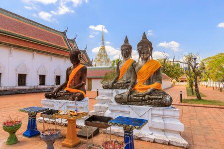 Buddha statues near relic pagoda stupa at Wat Phra Borommathat Chaiya Worawihan, Surat Thani 写真素材