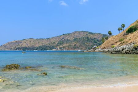 Beautiful clear blue sea at Ya Nui beach near Laem Promthep Cape, Phuket, Thailand