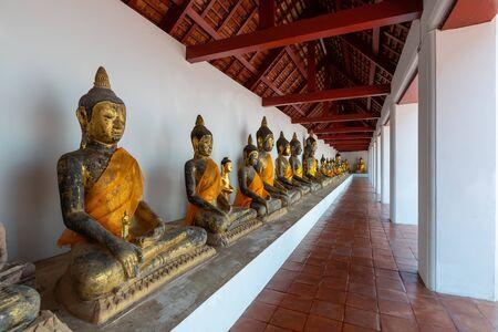 Corridor with Buddha statues at Wat Phra Borommathat Chaiya Worawihan, Surat Thani
