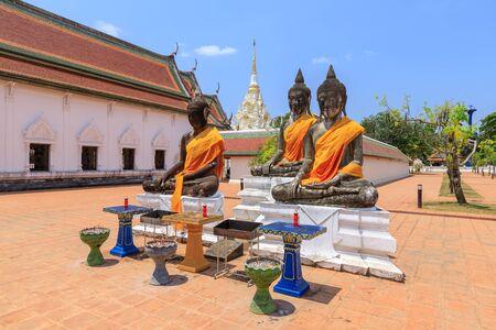 Buddha statues near relic pagoda stupa at Wat Phra Borommathat Chaiya Worawihan, Surat Thani Stock Photo